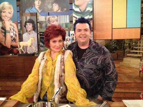 "Jason Santos and Sharon Osbourne on the set of her show ""The Talk."""